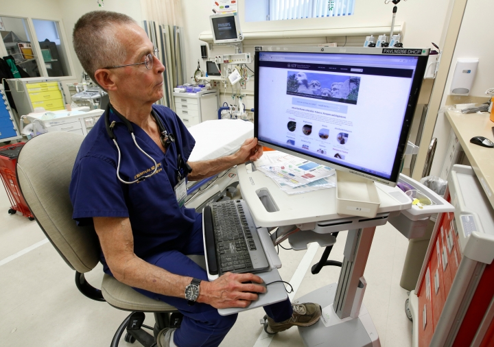 FILE - In this March 9, 2017 file photo, Dr. Garen Wintemute, an emergency room physician at the University of California, Davis, Medical Center, shows the website of the Bureau of Alcohol, Tobacco and Firearms, on a computer in the hospital in Sacramento, Calif. Gun deaths have fallen in California over a 16 year period ending in 2015, driven largely by a decline of African-American homicide victims, a recent and rare scientific study of firearm violence found. Researchers at the University of California, Davis published their findings in the May issue of Annals of Epidemiology after reviewing the 50,921 firearm deaths recorded in California between 2000 and 2015. The researchers said it's the first such deep analysis of California gun deaths in 30 years. (AP Photo/Rich Pedroncelli, File)