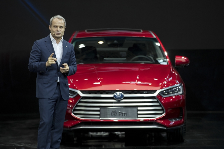 Wolfgang Egger, design director of Chinese automaker BYD, speaks after presenting the Qin Pro during a press conference at the China Auto Show in Beijing, Wednesday, April 25, 2018. Auto China 2018, the industry's biggest sales event this year, is overshadowed by mounting trade tensions between Beijing and U.S. President Donald Trump, who has threatened to hike tariffs on Chinese goods including automobiles in a dispute over technology policy. (AP Photo/Mark Schiefelbein)