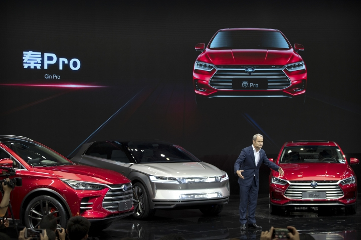 Wolfgang Egger, design director of Chinese automaker BYD, speaks after presenting a trio of vehicles during a press conference at the China Auto Show in Beijing, Wednesday, April 25, 2018. Auto China 2018, the industry's biggest sales event this year, is overshadowed by mounting trade tensions between Beijing and U.S. President Donald Trump, who has threatened to hike tariffs on Chinese goods including automobiles in a dispute over technology policy. (AP Photo/Mark Schiefelbein)