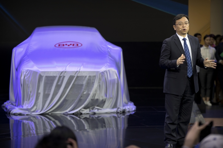Wang Chuanfu, the chairman and president of Chinese automaker BYD, speaks during a press conference at the China Auto Show in Beijing, Wednesday, April 25, 2018. Auto China 2018, the industry's biggest sales event this year, is overshadowed by mounting trade tensions between Beijing and U.S. President Donald Trump, who has threatened to hike tariffs on Chinese goods including automobiles in a dispute over technology policy. (AP Photo/Mark Schiefelbein)