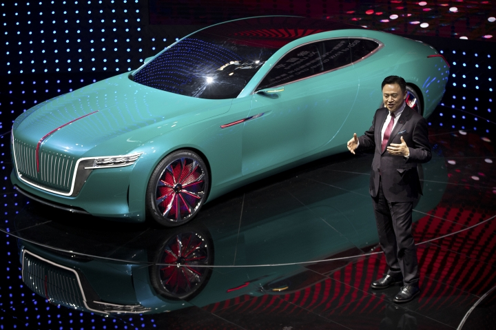 Xu Liuping, Chairman of the Board of Directors of China's state-owned FAW Group, speaks after presenting the Hongqi E-Jing GT electric concept car at the China Auto Show in Beijing, Wednesday, April 25, 2018. Auto China 2018, the industry's biggest sales event this year, is overshadowed by mounting trade tensions between Beijing and U.S. President Donald Trump, who has threatened to hike tariffs on Chinese goods including automobiles in a dispute over technology policy. (AP Photo/Mark Schiefelbein)