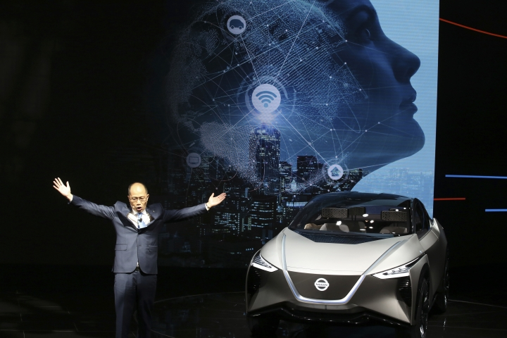 Chen Hao, Dongfeng Nissan Passenger Vehicle company's deputy managing director gestures near the Nissan IMX concept car during the start of the Auto China 2018 in Beijing, China, Wednesday, April 25, 2018. Volkswagen and Nissan have unveiled electric cars designed for China at the Beijing auto show that highlights the growing importance of Chinese buyers for a technology seen as a key part of the global industry's future. (AP Photo/Ng Han Guan)