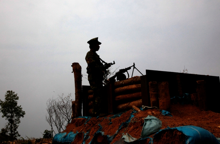 In this March 17, 2018 photo, a Kachin Independence Army rebel watches no man's land, towards Myanmar army front line from a outpost in Hpalap mountain, controlled by Kachin rebels in northern Kachin state, Myanmar. While the world is focused on attacks on Myanmar's Rohingya Muslims, a civil war rages, pitting government forces against another of the country's minorities, the Kachins, mostly Christian. It's one of the longest-running wars on Earth, and it has intensified dramatically in recent months, with at least 10,000 people been displaced since January alone, according to the United Nations. (AP Photo/Esther Htusan)