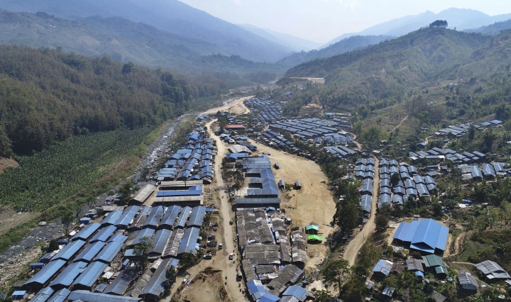 This March 18, 2018 areal photo provided by Information Department of the Kachin Independence Organization, shows Je Yang camp for refugees along the Chinese border in northern Kachin state, Myanmar. While the world is focused on attacks on Myanmar's Rohingya Muslims, a civil war rages, pitting government forces against another of the country's minorities, the Kachins, mostly Christian. It's one of the longest-running wars on Earth, and it has intensified dramatically in recent months, with at least 10,000 people been displaced since January alone, according to the United Nations. (Kachin Independence Organization via AP)