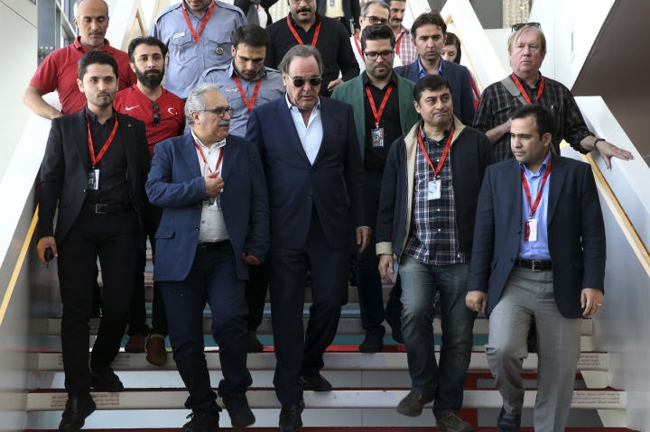 American movie director Oliver Stone, center, leaves at the conclusion of his news conference in the Fajr International Film Festival in Tehran, Iran, Wednesday, April 25, 2018. (AP Photo/Vahid Salemi)