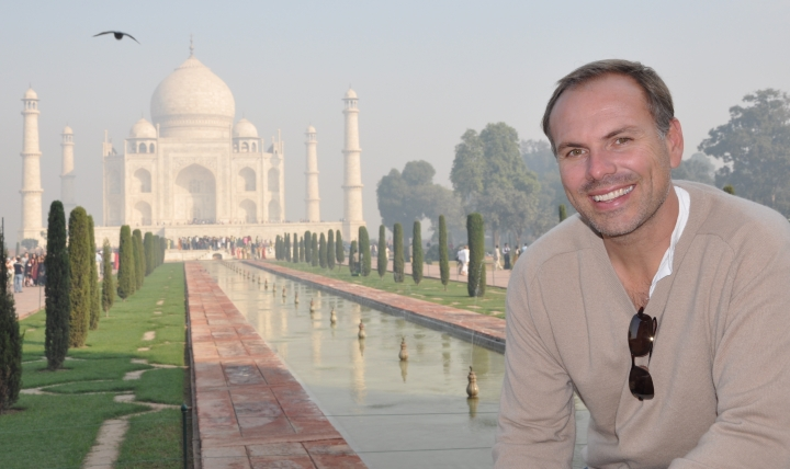 "This undated photo shows John DiScala, better known as the air travel expert Johnny Jet, at the Taj Mahal in Agra, India. DiScala offered tips and strategies for booking flights and getting the best deals for summer travel in an interview with the AP Travel podcast ""Get Outta Here!"" airing Wednesday, April 25. (Natalie DiScala via AP)"