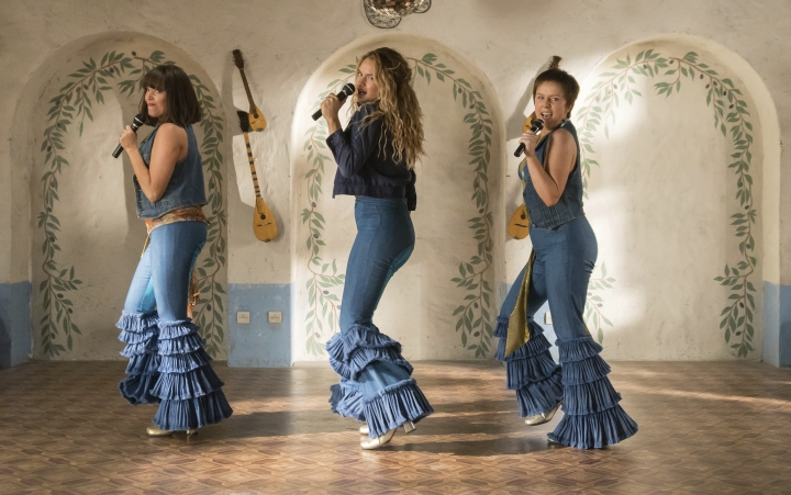 "This image released by Universal Pictures shows, from left, Jessica Keenan Wynn, Lily James and Alexa Davies in a scene from ""Mamma Mia! Here We Go Again,"" in theaters on July 20. (Jonathan Prime/Universal Pictures via AP)"