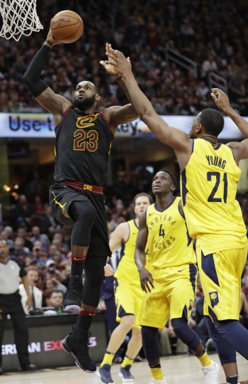 Cleveland Cavaliers' LeBron James (23) drives to the basket against Indiana Pacers' Thaddeus Young (21) in the first half of Game 5 of an NBA basketball first-round playoff series, Wednesday, April 25, 2018, in Cleveland. (AP Photo/Tony Dejak)