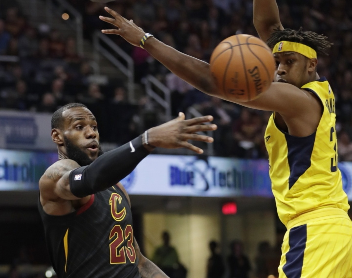 Cleveland Cavaliers' LeBron James (23) passes against Indiana Pacers' Myles Turner (33) in the first half of Game 5 of an NBA basketball first-round playoff series, Wednesday, April 25, 2018, in Cleveland. (AP Photo/Tony Dejak)