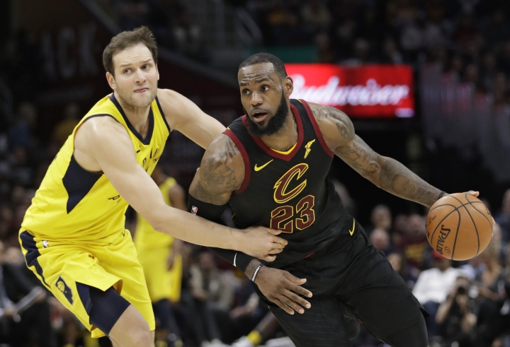Cleveland Cavaliers' LeBron James (23) drives past Indiana Pacers' Bojan Bogdanovic (44), from Croatia, in the first half of Game 5 of an NBA basketball first-round playoff series, Wednesday, April 25, 2018, in Cleveland. (AP Photo/Tony Dejak)