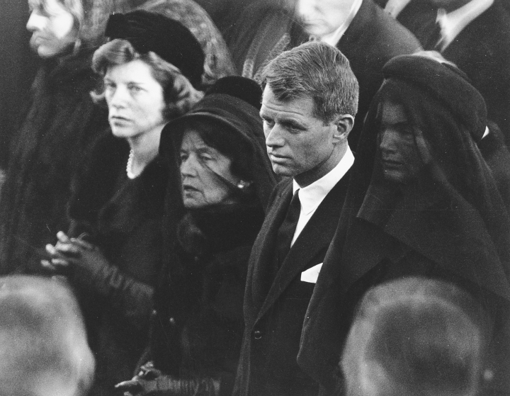 "FILE - In this Nov. 25, 1963 file photo members of the Kennedy family attend U.S. President John F. Kennedy's burial at Arlington National Cemetery in Arlington, Va., including JFK's mother, Rose Kennedy, center left with veil; his brother U.S. Attorney General Robert F. Kennedy, center right; and the president's widowed wife, Jacqueline Kennedy, far right. Robert F. Nearly 50 years after Robert F. Kennedy's assassination, a new documentary series on his life and transformation into a liberal hero is coming to Netflix. ""Bobby Kennedy for President"" produced by RadicalMedia, Trilogy Films and LooksFilm launches Friday, April 27, 2018, on Netflix. (AP Photo, File)"