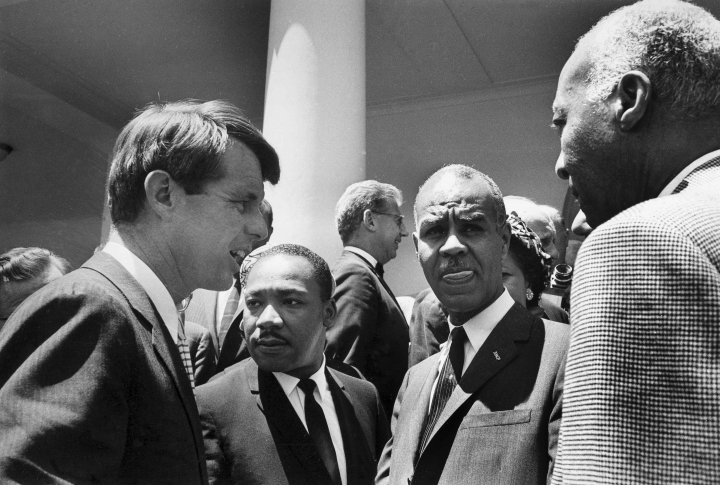 "FILE - In this June 22, 1963, file photo, U.S. Attorney General Robert F. Kennedy, left, speaks with civil rights leaders, beginning second from left, Rev. Martin Luther King, Jr., head of the Southern Christian Leadership Conference; Roy Wilkins, executive secretary of the NAACP; and A. Phillip Randolph, president of Brotherhood of Sleeping Car Porters, on the White House grounds, in Washington, DC. Civil rights lawyer Joseph Rauh stands in the background at center. Nearly 50 years after Robert F. Kennedy's assassination, a new documentary series on his life and transformation into a liberal hero is coming to Netflix. ""Bobby Kennedy for President"" produced by RadicalMedia, Trilogy Films and LooksFilm launches Friday, April 27, 2018, on Netflix. (AP Photo/Bob Schutz, File)"