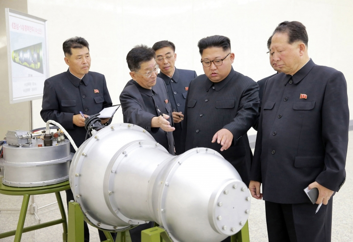 FILE - This undated file photo distributed on Sunday, Sept. 3, 2017, by the North Korean government, shows North Korean leader Kim Jong Un, second from right, at an undisclosed location in North Korea. A study by Chinese geologists shows the mountain above North Korea's main nuclear test site has collapsed under the stress of the explosions, rendering it unsafe for further testing and necessitating monitoring for any leaking radiation. The findings by the scientists at the University of Science and Technology of China may shed new light on North Korean President Kim Jong Un's announcement that his country was ceasing its testing program. (Korean Central News Agency/Korea News Service via AP, File)