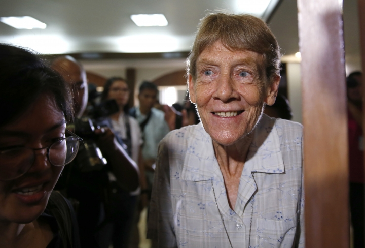 Australian Roman Catholic nun Sr. Patricia Fox leaves the venue following a news conference a day after the Bureau of Immigration forfeited her missionary visa and given 30 days to leave the country Thursday, April 26, 2018 in suburban Quezon city northeast of Manila, Philippines. The Australian nun whose missionary visa in the Philippines was revoked after the president complained about her joining opposition rallies said Thursday that social advocacy and human rights are part of church teachings.(AP Photo/Bullit Marquez)
