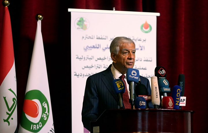 Iraqi Oil Minister Jabar Ali al-Luaibi speaks in Baghdad, Iraq, Thursday, April 26, 2018. Iraq has awarded the rights to explore and develop two gas fields and a hydrocarbon-rich area in the country's northeast. (AP Photo/Karim Kadim)