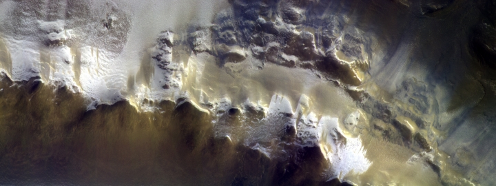 In this image provided by the European Space Agency, ESA, The ExoMars Colour and Stereo Surface Imaging System, CaSSIS, captured this view of the rim of Korolev crater (73.3ºN/165.9ºE) on 15 April 2018. The European Space Agency has released its first image taken by a probe orbiting Mars, showing the ice-covered edge of a vast crater. Scientists combined three pictures taken by the Trace Gas Orbiter's camera instrument, CaSSIS, from an altitude of 400 kilometers (249 miles) on April 15. (ESA/Roscosmos/CaSSIS via AP)