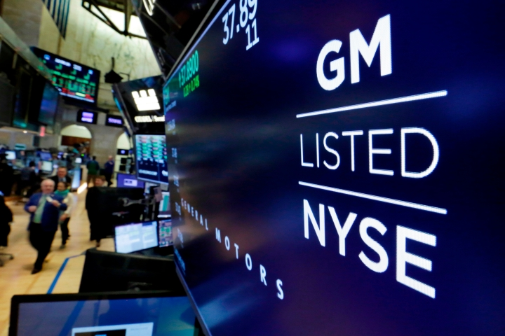 FILE- In this April 23, 2018, file photo, the logo for General Motors appears above a trading post on the floor of the New York Stock Exchange. General Motors Co. reports earns on Thursday, April 26. (AP Photo/Richard Drew, File)