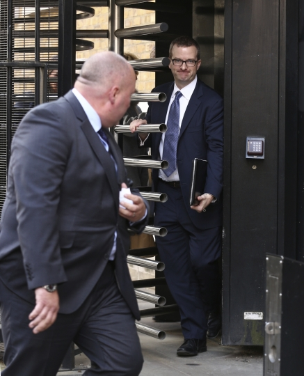 Chief Technical Officer of Facebook Mike Schroepfer leaves Portcullis House after giving evidence to a Parliamentary select committee on digital, culture, media and sport in London, Thursday, April 26, 2018. The UK parliament's media committee has criticized Facebook's response to allegations that data from millions of accounts was misused during elections in the United States and Britain as they grilled one of the company's senior executives about the scandal. (AP Photo)