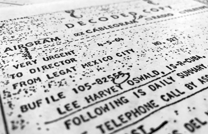 """Part of a file, dated April 5, 1964, details efforts to trace Lee Harvey Oswald's travel from Mexico City back to the United States, released for the first time on Thursday, Oct. 26, 2017, is photographed in Washington. President Donald Trump boasted last fall that he would open all remaining John F. Kennedy assassination records. So far, Trump hasn't made good on the """"great transparency"""" he promised then. Trump announced on April 26, 2018, that the public must wait another three years or more before seeing material that must remain classified for national security reasons — more than five decades after Kennedy was killed Nov. 23, 1963 in Dallas, Texas. (AP Photo/Jon Elswick)"""