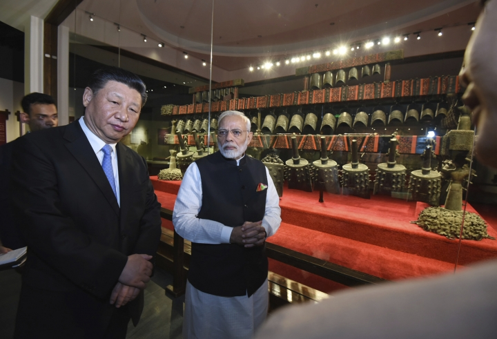 In this photo released by the Indian Ministry of External Affairs, Indian Prime Minister Narendra Modi, right, and Chinese President Xi Jinping visit the Hubei Museum in Wuhan, China, Friday, April 27, 2018. The leaders of India and China met at a lakeside resort in central China on Friday amid tensions along their contested border and a rivalry for influence among their smaller neighbors that could determine dominance in Asia. (Indian Ministry of External Affairs via AP)