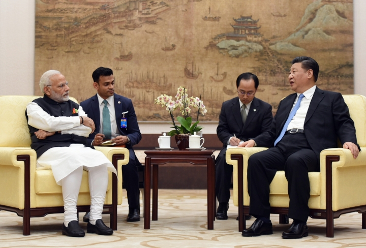 In this photo released by the Indian Ministry of External Affairs, Indian Prime Minister Narendra Modi, left, meets with Chinese President Xi Jinping in Wuhan, China, Friday, April 27, 2018. The leaders of India and China met at a lakeside resort in central China on Friday amid tensions along their contested border and a rivalry for influence among their smaller neighbors that could determine dominance in Asia. (Indian Ministry of External Affairs via AP)