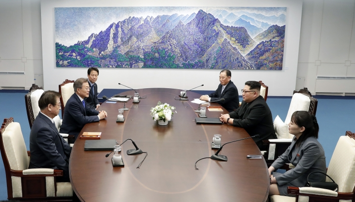 North Korean leader Kim Jong Un, second from right, and South Korean President Moon Jae-in, second from left, attend during a summit at Peace House of the border village of Panmunjom in the Demilitarized Zone, South Korea, Friday, April 27, 2018. North Korean leader Kim made history by crossing over the world's most heavily armed border to greet South Korean President Moon for talks on North Korea's nuclear weapons. At right is Kim's sister Kim Yo Jong. (Korea Summit Press Pool via AP)