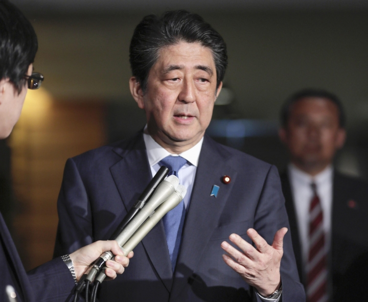 "Japanese Prime Minister Shinzo Abe speaks to journalists at at Prime Minister's office Friday, April 27, 2018, in Tokyo. Abe praised the talks Friday as a ""forward-looking move."" He told reporters in Tokyo that he expects North Korea to take concrete actions toward denuclearization through its planned talks with the U.S. (Shin Kigeuchi/Kyodo News via AP)"