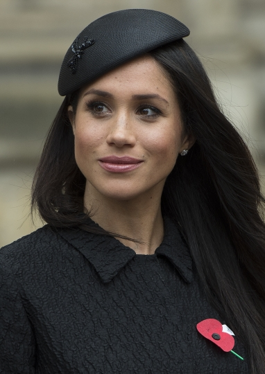 Meghan Markle, fiancee of Britain's Prince Harry attends a Service of Thanksgiving and Commemoration on ANZAC Day at Westminster Abbey in London, Wednesday, April 25, 2018. (Eddie Mulholland/Pool via AP)