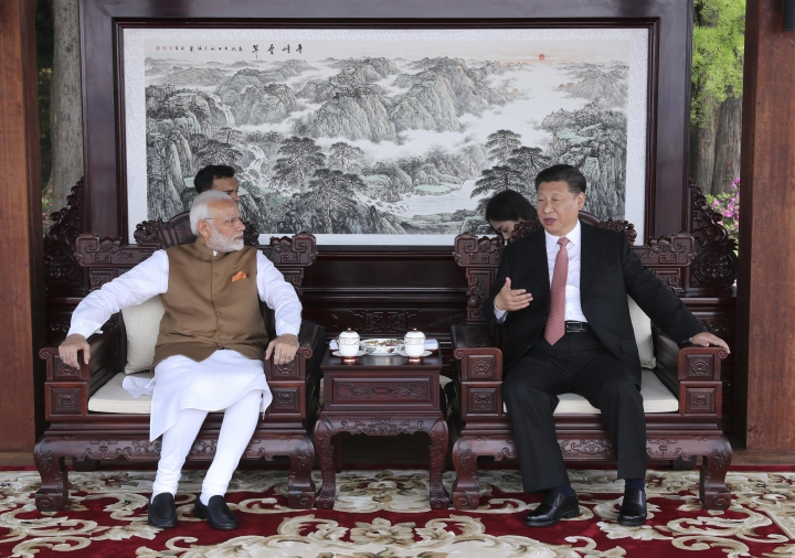 In this photo released by China's Xinhua News Agency, Indian Prime Minister Narendra Modi, left, and Chinese President Xi Jinping talk during a meeting in Wuhan in central China's Hubei Province, Saturday, April 28, 2018. The leaders of China and India stressed the importance of close ties in talks Saturday, against the background of their rivalry for leadership in Asia and the potential for cooperation on economic and security matters. (Pang Xinglei/Xinhua via AP)