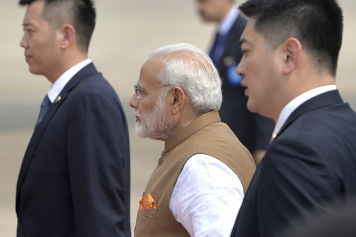 Indian Prime Minister Narendra Modi, center, prepares to board his plane at the airport in Wuhan in central China's Hubei Province, Saturday, April 28, 2017. The leaders of China and India stressed the importance of close ties in talks Saturday, against the background of their rivalry for leadership in Asia and the potential for cooperation on economic and security matters. (Chinatopix via AP)