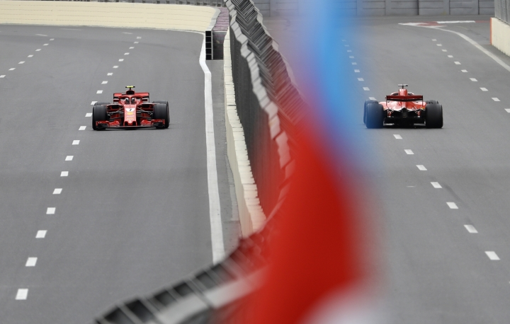 Ferrari driver Kimi Raikkonen of Finland, left, and Ferrari driver Sebastian Vettel of Germany steer their cars during the third free practice session at the Baku Formula One city circuit, in Baku, Azerbaijan, Saturday, April 28, 2018. The Formula One race will be held on Sunday. (AP Photo/Luca Bruno)