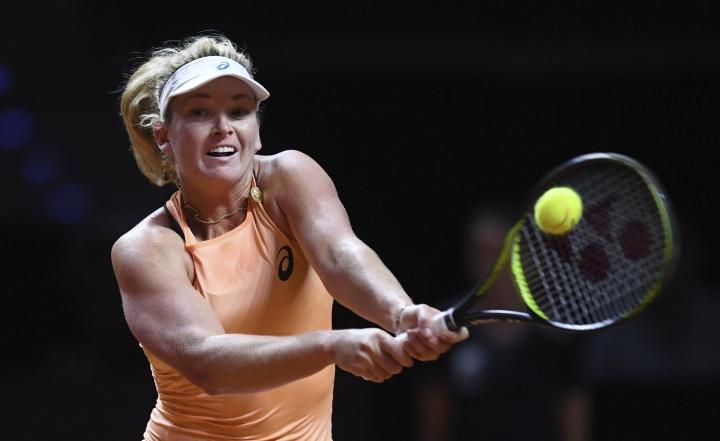 Coco Vandeweghe from the U.S. returns a shot to France's Caroline Garcia, in their semifinal match of the WTA tennis tournament in Stuttgart, Germany, Saturday, April 28, 2018. (Marijan Murat/dpa via AP)