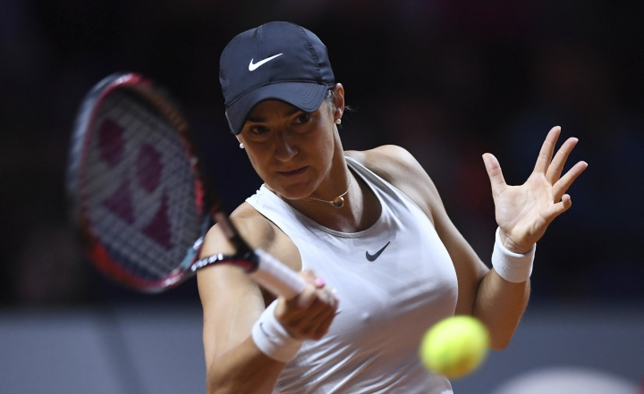 Caroline Garcia returns a shot to Coco Vandeweghe from the U.S. during their semifinal match of the WTA tennis tournament in Stuttgart, Germany, Saturday, April 28, 2018. (Marijan Murat/dpa via AP)