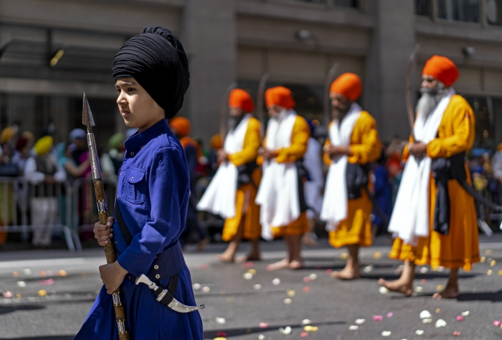 "Bir Singh, 7, of Hicksville, N.Y., marches near the front of the Sikh Day Parade, an annual Nagar Keertan ""meditation celebration"" Saturday, April 28, 2018, in New York. (AP Photo/Craig Ruttle)"
