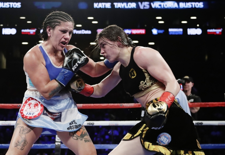 Ireland's Katie Taylor, and Argentina's Victoria Noelia Bustos trade blows during the ninth round of a women's lightweight championship boxing match Saturday, April 28, 2018, in New York. Taylor won the fight. (AP Photo/Frank Franklin II)
