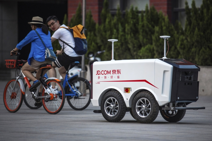 "This undated image provided by JD.com shows an autonomous delivery vehicle. Dr. Hui Cheng, the head of robotics research at JD.'s Silicon Valley Research Center, recently spoke with The Associated Press about the priorities of the lab, the ""spoiled"" Chinese consumer and the prospect of talking robots. Under Cheng, who previously worked on Amazon Go's cashier-less store project, JD is working on areas like artificial intelligence. (JD.com via AP)"