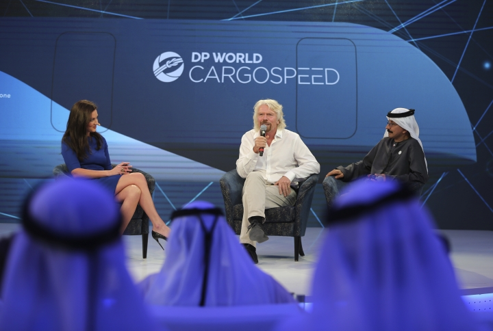 Richard Branson, center, talks next to Sultan Ahmed bin Sulayem during the Hyperloop One presentation aboard the Queen Elizabeth 2 in Dubai, United Arab Emirates, Sunday, April 29, 2018. DP World's chairman and CEO Sultan Ahmed bin Sulayem said Sunday that Virgin Hyperloop One would launch a freight service called DP World Cargospeed. (AP Photo/Kamran Jebreili)