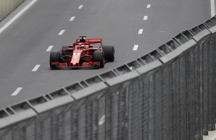 Germany driver Sebastian Vettel steers his Ferrari during the Azerbaijan Formula One Grand Prix, at the city circuit, in Baku, Azerbaijan, Sunday, April 29, 2018. (AP Photo/Luca Bruno)