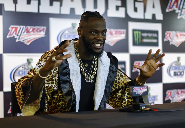 WBC Heavyweight Champion Deontay Wilder speaks at a press conference before the GEICO 500 NASCAR Talladega auto race at Talladega Superspeedway, Sunday, April 29, 2018, in Talladega, Ala. (AP Photo/Butch Dill)