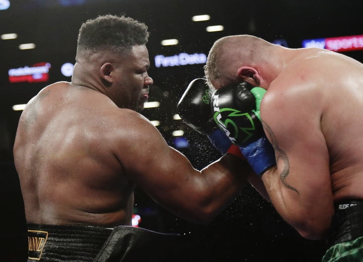 Jarrell Miller, left, punches Johann Duhaupas, of France, during the fifth round a heavyweight boxing match Saturday, April 28, 2018, in New York. Miller won the fight. (AP Photo/Frank Franklin II)