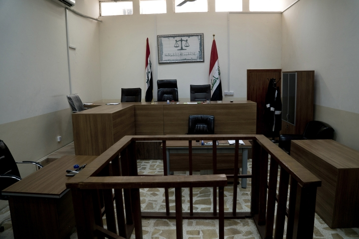This Thursday, April 26, 2018 photo shows an empty courtroom at Nineveh Criminal Court, one of two counterterrorism courts in Iraq where suspected Islamic State militants and their associates are tried, in Tel Keif, Iraq. (AP Photo/Maya Alleruzzo)