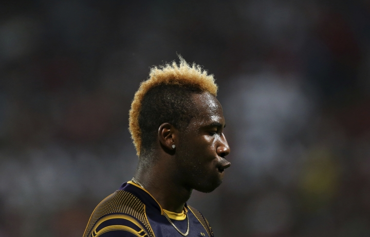 Kolkata Knight Riders' Andre Russell gestures as he walks to take his fielding position during the VIVO IPL Twenty20 cricket match against Royal Challengers Bangalore in Bangalore, India, Sunday, April 29, 2018. (AP Photo/Aijaz Rahi)