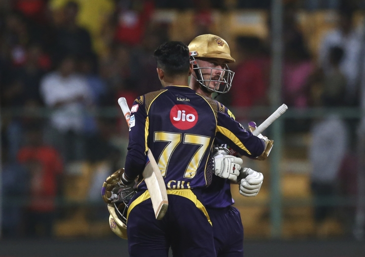 Kolkata Knight Riders' Chris Lynn, right, hugs teammate Shubman Gill to celebrate their win in the VIVO IPL Twenty20 cricket match against Royal Challengers Bangalore in Bangalore, India, Monday, April 30, 2018. Kolkata Knight Riders won the match by six wickets. (AP Photo/Aijaz Rahi)