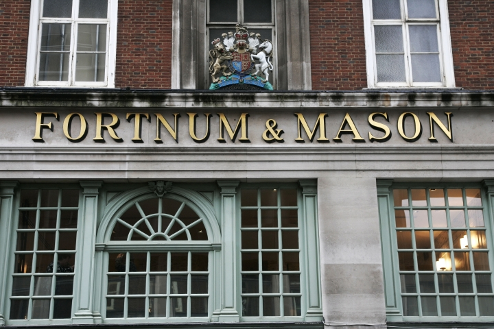 FILE - This Jan. 28, 2009, file photo, shows the Fortnum & Mason store in London, also bearing the Royal Coat of Arms above, declaring by appointment to Her Majesty Queen Elizabeth II. Fans of the British royals will want to include castles, Westminster Cathedral and other sites connected to Queen Elizabeth II and her family on any trip to England. (AP Photo/Sang Tan, File)