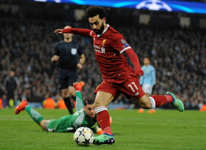 FILE - In this April 10, 2018, file photo, Liverpool's Mohamed Salah scores his side's first goal during the Champions League quarterfinal second leg soccer match against Manchester City in Manchester, England. Premier League leading scorer Salah said Sunday, April 29, 2018, he is insulted over the unauthorized use of his image and blames the Egyptian Football Association in a dispute that comes less than two months before the World Cup in Russia. (AP Photo/Rui Vieira, File)