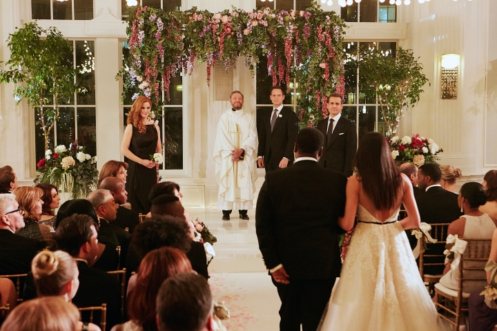 """This image released by USA Network shows a wedding scene from the """"Good-Bye"""" episode of """"Suits."""" Meghan Markle's character dreams of getting married at the Plaza Hotel in New York City, though the scene was filmed at the Fairmont Royal York in Toronto. Both hotels are hosting royal-themed events in honor of Markle's wedding to Prince Harry. (Ian Watson/USA Network via AP)"""
