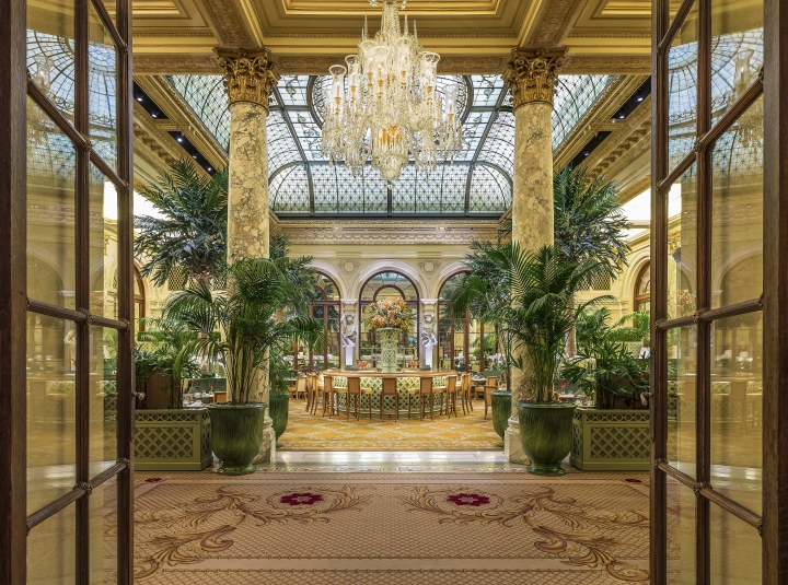 This undated photo provided by the Plaza in New York City shows the hotel's Palm Court, known for its elaborate afternoon teas. On May 19, the hotel is hosting a $150 Champagne breakfast in the Palm Court with livestreaming of the royal wedding of Prince Harry and Meghan Markle. Guests are encouraged to wear hats and gloves. It's one of a number of royal wedding-themed events being offered by hotels. (The Plaza via AP)