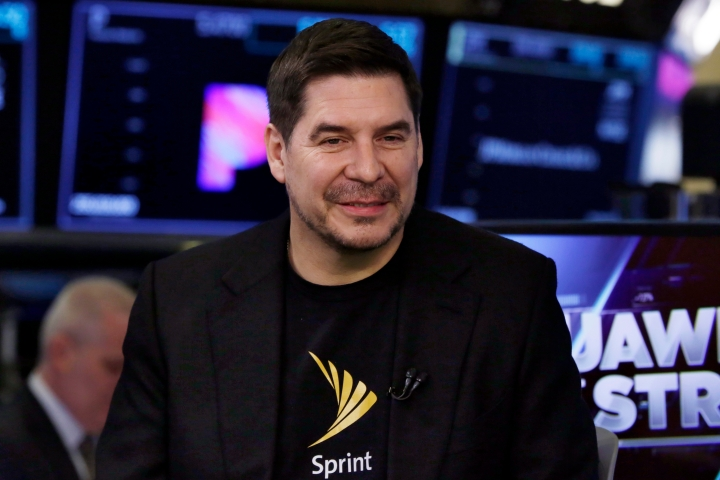 Sprint CEO Marcelo Claure is interviewed on the floor of the New York Stock Exchange, Monday, April 30, 2018. To gain approval for their $26.5 billion merger agreement, T-Mobile and Sprint aim to convince antitrust regulators that there is plenty of competition for wireless service beyond Verizon and AT&T. (AP Photo/Richard Drew)