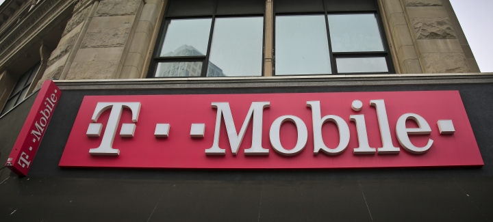This photo shows signage a T-Mobile store in New York, Monday, April 30, 2018. Consumer advocacy groups are worried that T-Mobile's bid for Sprint could lead to higher prices on cellphone plans. (AP Photo/Bebeto Matthews)