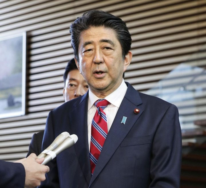 In this April 29, 2018 photo, Japanese Prime Minister Shinzo Abe speaks to journalists at the Prime minister's office in Tokyo. Abe, in a statement issued Tuesday, May 1, 2018, said he wants the status of Japan's self-defense force spelled out as military, as he desperately seeks to take a crack at a revision. Opponents say it could expand Japan's military role beyond its current limit. (Shin Kigeuchi/Kyodo News via AP)